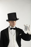 Magician holding playing cards Stock Photo