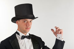 Magician holding playing cards Stock Photography