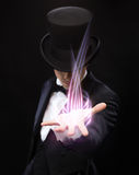 Magician holding something on palm of his hand. Magic, performance, circus, show and advertisement concept - magician holding something on palm of his hand Royalty Free Stock Image