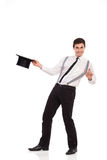 Magician holding top hat. Happy young man holding top hat. Full length studio shot  on white Stock Image