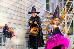 Magician holiday. Happy children in a costumes of witches and wizards celebrating halloween. Trick or treat. Halloween party Stock Photo