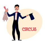 Magician, illusionist conjuring rabbit out of hat, artist performer Stock Photos