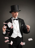 Magician juggle cards Stock Photography