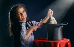 Magician. The little magician does tricks royalty free stock photo