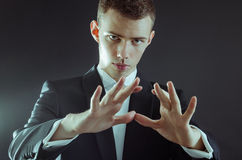 Magician. Looking at hands for pose royalty free stock photography