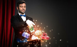 Magician with magic Christmas box. Performs the trick stock photo