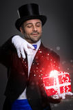 Magician with magic gift. Magician performs the trick with magic gift royalty free stock photos