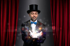 Magician with magic on palm. Magician holding magic on palm of his hand stock images