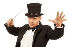 Magician with magic wand Royalty Free Stock Photo