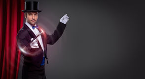 Magician with  magic wand. In action Stock Image