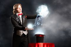 Magician. Makes passes at the cylinder, the cylinder produces magic Royalty Free Stock Image
