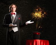 Magician. Makes passes at the cylinder, the cylinder produces magic Stock Photo