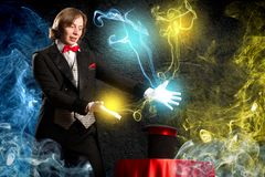 Magician. Makes passes at the cylinder, the cylinder produces magic Stock Photography