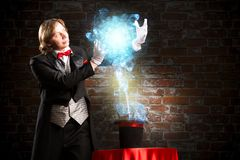 Magician. Makes passes at the cylinder, the cylinder produces magic Stock Image
