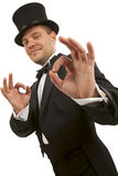Magician making 'ok' gesture Stock Photos