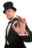 Magician making 'ok' gesture Royalty Free Stock Photo