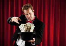 Magician: Man Ready to Make Cash Disappear. Series about a magician in a traditional tuxedo, with various props, looking mysterious and magical stock photos