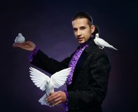 Magician man in stage costume Royalty Free Stock Photography