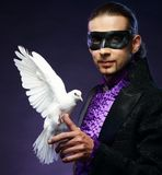 Magician man in stage costume Stock Photos