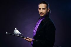 Magician man in stage costume Stock Photography