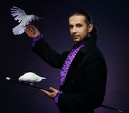Magician man in stage costume Stock Photo
