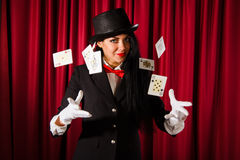 Magician with a pack of playing cards Royalty Free Stock Photos