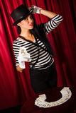 Magician with a pack of playing cards Royalty Free Stock Images