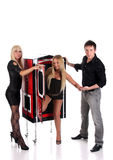 Magician performance girls in a magic box Royalty Free Stock Photos