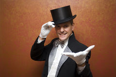 Magician performing. A magic trick Royalty Free Stock Photo