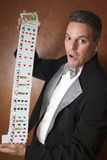 Magician performing card trick. Magician make performance with card deck Royalty Free Stock Photography