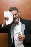 Magician performing with cards. Magician make performance with card deck Royalty Free Stock Photography