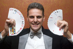 Magician performing with cards. Magician make performance with card deck Stock Image