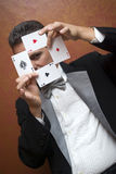 Magician performing with cards. The illusionist performing with cards Royalty Free Stock Photo