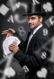 Magician performing trick with playing cards Royalty Free Stock Photos