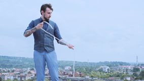 Magician performing trick with rope. Magic performer illusionist, disappears and rises. Cord artist. Cabaret show or. Circus entertainment performance. Animator stock video
