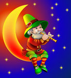 magician plays on flute sitting on moon in the night Stock Photos