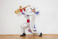 Magician plays the trumpet Stock Image