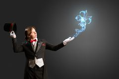 Magician produces multicolored smoke Royalty Free Stock Image