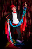 Magician pulling colorful handkerchiefs Royalty Free Stock Images