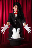 Magician with a rabbit in a hat Royalty Free Stock Images