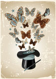 Magician's hat. Vintage background with magician's hat, wand and butterflies Royalty Free Stock Photography