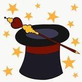 The magician`s hat and magic wand surrounded by stars.  Royalty Free Stock Photo