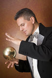 Magician's magic trick. Magician performing a magic trick Royalty Free Stock Images