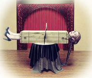Magician sawing a woman. With a saw.Photo combination concept Royalty Free Stock Photo