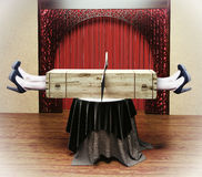 Magician sawing a woman royalty free stock image