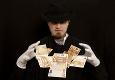 Magician show with euro banknote Stock Photo