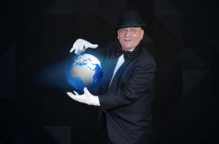 Magician showing globe hologram Stock Photo
