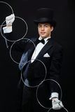 Magician showing trick with linking rings Stock Images