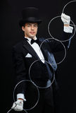 Magician showing trick with linking rings Royalty Free Stock Photos