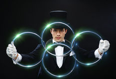 Magician showing trick with linking rings Stock Image